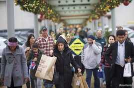Shoppers walk a connecting path from The Court to The Plaza at the King of Prussia Mall, United State's largest retail shopping space, in King of Prussia, Pennsylvania, Dec. 6, 2014.