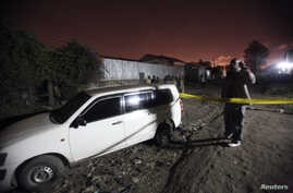 A man stands at the scene after two successive blasts in the residential area of Eastleigh Estate in Nairobi, Kenya, October 12, 2012.