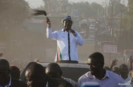 Kenyan opposition leader Raila Odinga, the presidential candidate of the National Super Alliance (NASA) coalition, waves to supporters as he leaves from their campaign rally at the Kamukunji grounds in Nairobi, July 7, 2017.