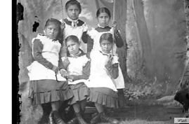 Portrait of group of Carlisle Indian Industrial School students in uniform, 1894. Photo by John N. Choate. Photo Lot 81-12 06820900, National Anthropological Archives, Smithsonian Institution, Washington, D.C.