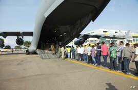 Indian nationals board an Indian Air Force plane July 14, 2016, as they leave Entebbe International Airport, Uganda, to go back home after arriving from Juba, South Sudan. The United States, India and other countries continue to evacuate their citize