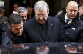 Australian Cardinal George Pell leaves at the end of a meeting with the victims of sex abuse, at the Quirinale hotel in Rome, Italy, March 3, 2016.