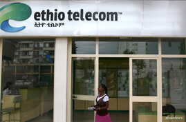 A woman walks past an Ethio Telecom office in Ethiopia's capital, Addis Ababa, Nov. 9, 2015.