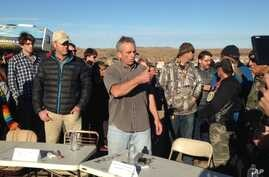 Robert F. Kennedy Jr., center, an environmental attorney and president of the New York-based Waterkeeper Alliance, speaks with opponents of the Dakota Access oil pipeline at the main protest camp, Nov. 15, 2016, near Cannon Ball, North Dakota.
