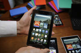 FILE - In this Sept. 16, 2015, file photo, Amazon's Fire tablet is displayed in San Francisco.  Amazon has removed the ability to encrypt locally stored data on its Fire tablets because it says customers weren't using the service.