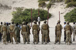 Hassan Hanafi Haji is tied to a wooden post as he is prepared to be executed by firing squad at a police academy in the capital Mogadishu, Somalia Monday, April 11, 2016.