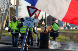 Protesters wearing yellow vests occupy a roundabout in Somain, France, Dec.13, 2018.