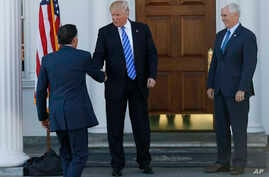 President-elect Donald Trump, center, and Vice President-elect Mike Pence, right, greet Mitt Romney, left, as he arrives at Trump National Golf Club Bedminster clubhouse in Bedminster, N.J., Saturday, Nov. 19, 2016.