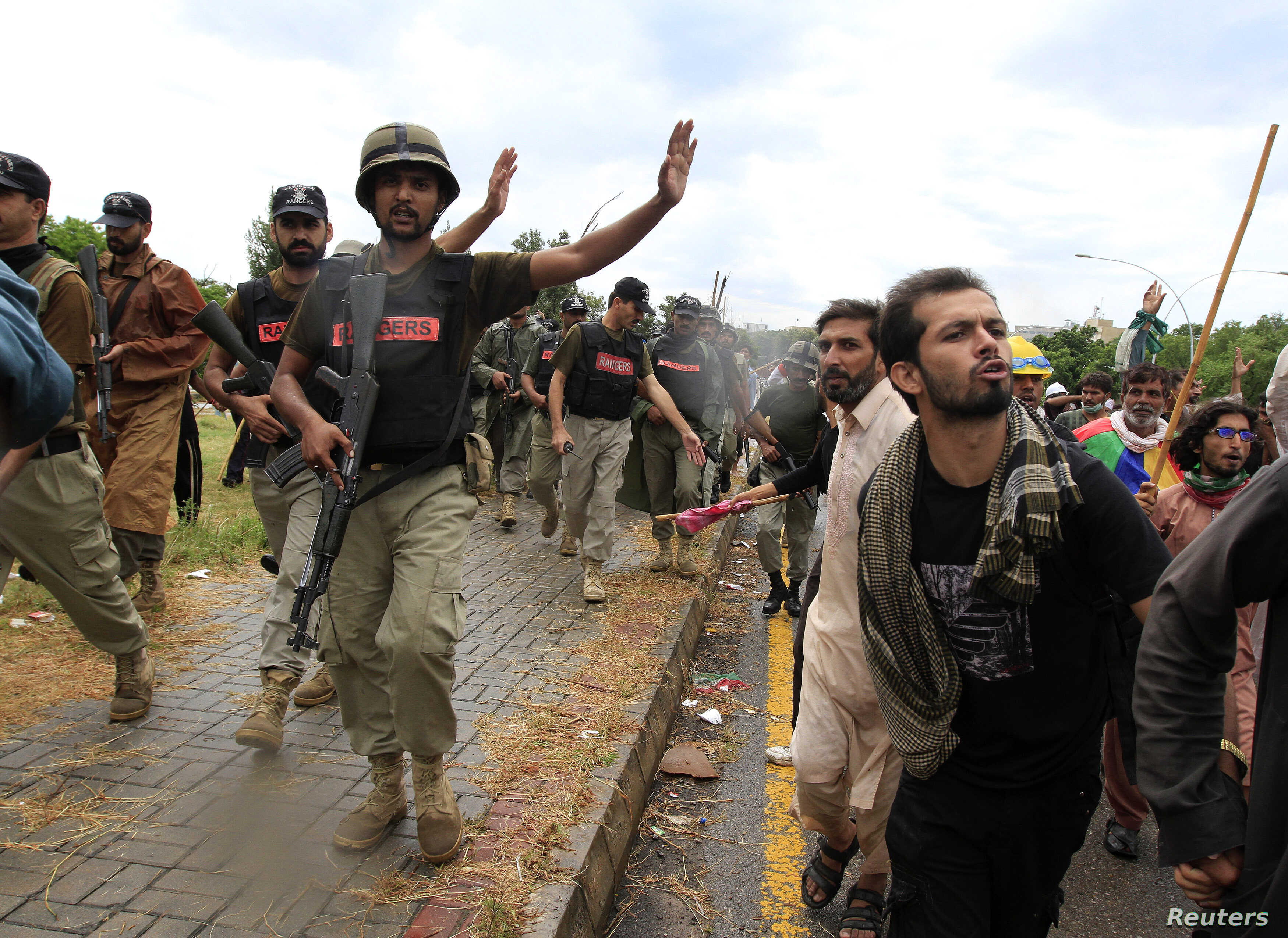 Soldiers from the Pakistan Rangers stop demonstrators during the Revolution March in Islamabad, Sept. 1, 2014.