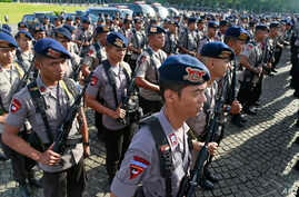 "Members of Indonesian National Police elite unit ""Mobile Brigade"" stand in attention during a security show of force ahead of Christmas and New Year celebrations at the National Monument in Jakarta, Indonesia, Thursday, Dec. 22, 2016."