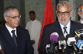 Morocco's Prime Minister Abdelilah Benkirane (R) and his Libyan counterpart Ali Zeidan speak to the media during a press conference in Rabat, Morocco, Oct. 8, 2013.