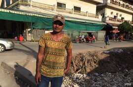 Thin Seangly stands outside his home in Phnom Penh (P. Bopha/VOA News)