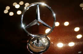 FILE - The logo of a Mercedes car is photographed during an annual press conference of Daimler AG in Stuttgart, Germany.