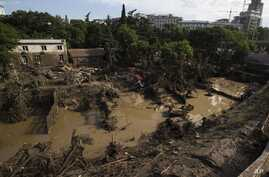 A destroyed flooded zoo area is seen in Tbilisi, Georgia, June 15, 2015.