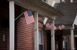 FILE - Flags are posted on the home of Keonna Thomas, accused of trying to join and martyr herself for the Islamic State group in Syria, April 3, 2015, in Philadelphia, Pennsylvania.