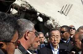 UN Secretary General Ban Ki-moon, centre, visits a destroyed house in Jebaliya, northern Gaza Strip, Sunday, March 21, 2010. U.N. chief Ban Ki-moon has entered the blockaded Gaza Strip, where 1.5 million people have been under lockdown by Israel and