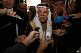 Saudi Arabia's Minister of Petroleum and Mineral Resources Ali Ibrahim Naimi speaks to journalists at a hotel in Vienna, Austria, Tuesday, Dec. 1, 2015, prior to  the OPEC oil  ministers' meeting on Friday.