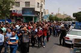 In this photo sent by an Iranian citizen journalist and verified by VOA Persian, a crowd of anti-government protesters marches in the city of Karaj, adjacent to Tehran, Aug. 2, 2018.