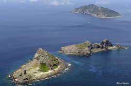 FILE - Parts of archipelagos, known as Senkaku in Japan and Diaoyu in China, are seen in the East China Sea.