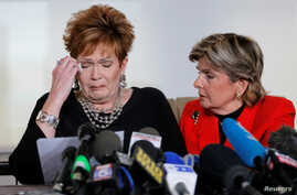 Beverly Young Nelson, left, reacts as she reads a statement to reporters with attorney Gloria Allred during a news conference announcing new allegations of sexual misconduct against Alabama Republican congressional candidate Roy Moore, in New York, N...