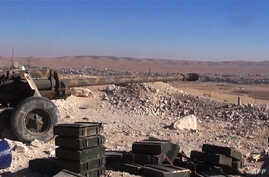 Cannon aims at rebel positions in strategic rebel-held Yabroud area, near Damascus, Feb. 15, 2014.