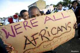 Migrants in Cape Town's Mannenberg community demonstrate against xenophobia. (UTERS/Mike Hutchings)