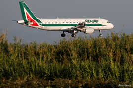 An Alitalia Airbus A320-200 airplane approaches to land at Fiumicino airport in Rome, Italy, Oct. 24, 2018.