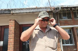 Theodro Bronkhorst, a professional hunter, appears at the magistrates court on the first day of trial in Hwange, Zimbabwe, Sept. 28, 2015.