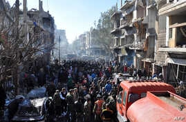 Syrians gather at the site of a car bomb explosion in al-Zahra neighborhood in Homs, Dec. 12, 2015. Fifteen civilians were killed and dozens more wounded when the car bomb struck the central Syrian city of Homs, the provincial governor told.
