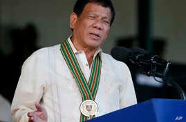 Philippine President Rodrigo Duterte addresses army troops during the 120th anniversary celebration of the Philippine Army, April 4, 2017 at Fort Bonifacio, suburban Taguig city, east of Manila, Philippines.