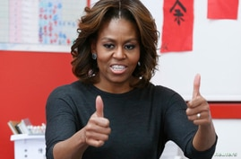U.S. first lady Michelle Obama gestures during a language class for pre-school students at the Washington Yu Ying Public Charter School ahead of her upcoming trip to China, in Washington, Mar. 4, 2014.