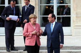 French President Francois Hollande (R) and German Chancellor Angela Merkel arrive to pose for a family photo during the Balkans summit, at the Elysee Palace, in Paris, France, July 4, 2016.