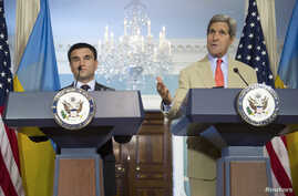 U.S. Secretary of State John Kerry (R) and Ukrainian Foreign Minister Pavlo Klimkin speak to reporters at the State Department in Washington, Tuesday, July 29, 2014.