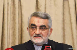 FILE - Alaeddin Boroujerdi, head of the Iranian parliamentary committee for national security and foreign policy, attends a news conference at the Iranian embassy.