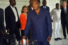 FILE - photo taken on March 20, 2016, Congo incumbent President Denis Sassou N'Guesso casts his ballot, at a polling station, in Brazzaville, Congo.