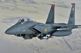 FILE - A U.S. Air Force F-15E Strike Eagle in-flight over Afghanistan, Oct. 7 2008.