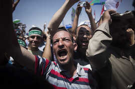 An Egyptian man chants slogans supporting Egyptian President Mohammed Morsi during a rally in Cairo, Egypt, June 21, 2013.
