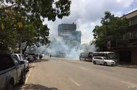 Riot police fire tear gas to disperse small groups of people gathering near the electoral commission headquarters in Nairobi ahead of a planned opposition demonstration that authorities say is illegal, May 24, 2016. (Photo: J.Craig/VOA)