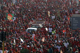 Members of the Economic Freedom Fighters party march for economic transformation in Johannesburg, South Africa, Oct. 27, 2015.