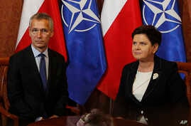 NATO Secretary General Jens Stoltenberg, left, and Polish Prime Minister Beata Szydlo pose for photographs prior to a meeting in Warsaw, Poland, Aug. 25, 2017.