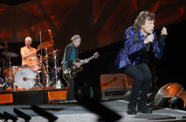 """Mick Jagger, right, performs with Keith Richards, center, and Charlie Watts on drums as The Rolling Stones play in their """"Zip Code"""" tour in Pittsburgh, June 20, 2015."""