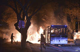 Firefighters work at a scene of fire from an explosion in Ankara that killed 28 people, Feb. 17, 2016.