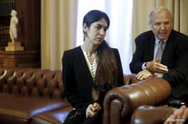 FILE - Nadia Murad Basee Taha, a 21-year-old Iraqi woman of the Yazidi faith who was abducted and held by the Islamic State for three months, meets with Greek President Prokopis Pavlopoulos (not pictured) at the Presidential Palace in Athens, Greece,