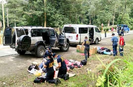 Police inspect the contents of the vehicles following an operation in Makilala township, North Cotabato province, in the southern Philippines, Oct. 28, 2016