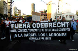 "People take part in a march against the Brazilian construction firm Odebrecht in Panama City, Panama, Jan. 25, 2017. The banner reads ""Get Out Odebrecht, Jail for the thieves."""