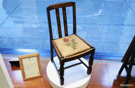 "A chair used by British author J.K. Rowling while writing ""Harry Potter and the Sorcerer's Stone"" and ""Harry Potter and the Chamber of Secrets"" is shown in the window of Heritage Auctions in New York, April 4, 2016."