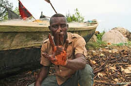 A fisherman shows oil slick on his palm, by the shore of the Niger Delta region in Brass, Nigeria, Dec. 2, 2013.