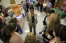 This Oct. 9, 2012, photo shows Utah Republican candidate Mia Love talking with students during the Granite PTA meet the candidates at Skyline High School in Salt Lake City.