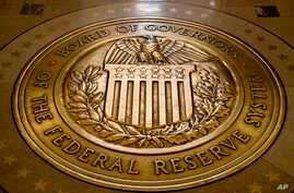 FILE -  the seal of the Board of Governors of the United States Federal Reserve System in the ground at the Marriner S. Eccles Federal Reserve Board Building in Washington.