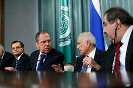 Secretary-General of the Arab League Nabil Elaraby, (2R), speaks to Russian Foreign Minister Sergey Lavrov, (3L), as Lebanese Minister of Foreign Affairs Adnan Mansour, (2L), Egyptian Foreign Minister Mohammed Kamel Amr, (L), and Iraqi Foreign Minist